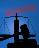 Medical malpractice concept. Court gavel and scales with Malpractice stamp stock photo
