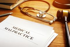 Medical malpractice report and stethoscope. Medical malpractice report documents and stethoscope stock image