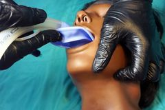 Medical manipulation for airway management. Laryngeal mask airway insertion by stuff in a black gloves on a simulation mannequin. Dummy during medical training royalty free stock image