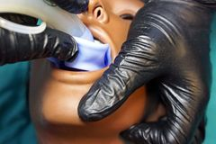 Medical manipulation for airway management. Laryngeal mask airway insertion by stuff in a black gloves on a simulation mannequin. Dummy during medical training royalty free stock photography