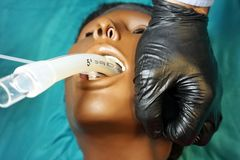 Medical manipulation for airway management. Laryngeal mask airway insertion by stuff in a black gloves on a simulation mannequin. Dummy during medical training royalty free stock photo