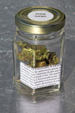 Medical marijuana. Jar with a warning from the state of California. Cannabis Chemdawg Stock Image