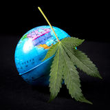 Medical marijuana concept with cannabis leaf and earth globe royalty free stock image