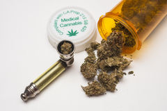 Medical marijuana and pipe. On white background royalty free stock photos