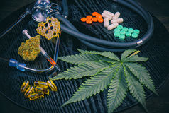 Medical marijuana products vs conventional pills concept stock photography