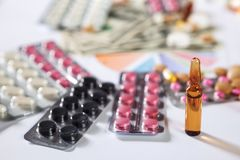 Medical marketing and healthcare business analysis report with g. Raph and many. Pile of pills in blister packs background Royalty Free Stock Photos