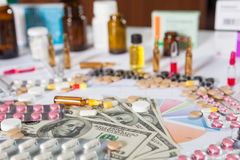 Medical marketing and healthcare business analysis report with graph. And many. Pile of pills in blister packs background Stock Image