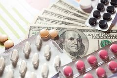 Medical marketing and healthcare business analysis report with graph. And many. Pile of pills in blister packs background Royalty Free Stock Image