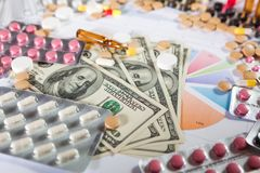 Medical marketing and healthcare business analysis report with graph. And many. Pile of pills in blister packs background Royalty Free Stock Images