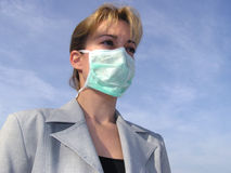 Medical mask. Blonde woman wearing a surgeon mask for protection Royalty Free Stock Photo