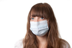 Medical mask. The girl in a medical mask on a white background stock photo