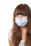 Medical mask. The girl in a medical mask on a white background Stock Photos