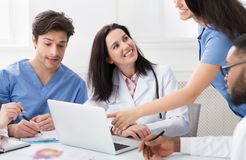 Medical Meeting. Successful Doctors Using Laptop In Hospital royalty free stock image