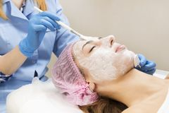 Medical micro needle therapy with a modern medical instrument derma roller. Stock Photos