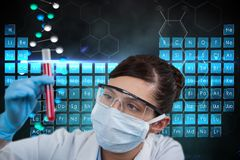 Medical models is holding a test tube against DNA graphics backgrounds royalty free stock image