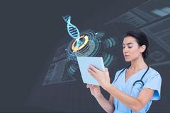 Medical models touching tablet computer against DNA graphics backgrounds royalty free stock photography