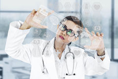 Medical modern technology. Image of young woman doctor. Concept of modern technology Stock Images
