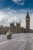 Medical motorcycle and Big Ben. LONDON, UK - MARCH 6, 2016: NHS motorcycle ambulance crosses Westminster Bridge Royalty Free Stock Photos