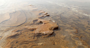 Medical mud on the shore of the Dead Sea, Jordan Stock Image