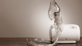 Medical nebulizer for the treatment of bronchitis. Camera agains. Medical nebulizer for the treatment of bronchitis royalty free stock image