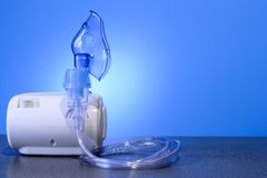 Medical nebulizer for the treatment of bronchitis. Camera agains. Medical nebulizer for the treatment of bronchitis stock photography