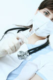 Medical needle in doctor hands Stock Image