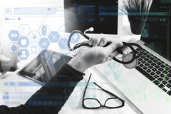 Medical network technology concept. Doctor hand working with ste Stock Images