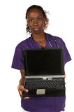 Medical Nurse. African American nurse with stethoscope and a notebook computer Stock Photos