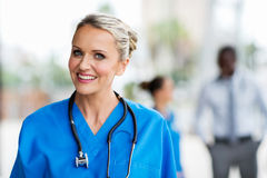 Medical nurse with colleagues Stock Image
