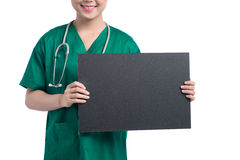 Medical nurse doctor showing black board. With copy space for your text or design. Mixed race Asian Chinese / Caucasian female medical professional smiling Stock Image