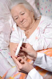 Medical nurse measuring the blood sugar level Stock Image