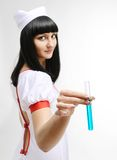 Medical nurse with a test tube Stock Image
