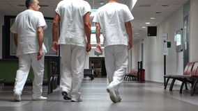 Medical and nursing staff walking in the hospital. stock video footage