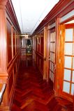 Corridor. Its corridor of medical office with brown wooden details on the floor and  doors and walls,looks reach and very expansive ,red oak, rare trees, trim Stock Images