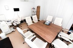 Medical office with ultrasound equipment and conference table Royalty Free Stock Photo