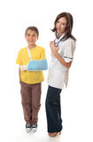 Medical officer with injured child. Medical officer stands beside an injured young boy Stock Photography