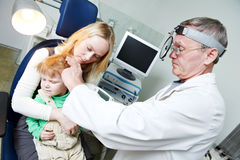 Medical otitus examination of child doctor. Medical otitus examination of a little child at a ear nose throat doctor Stock Images