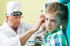 Medical otitus examination of child doctor. Medical otitus examination of a little child at a ear nose throat doctor Stock Photography