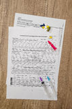 Medical patient form with pills and  syringes Royalty Free Stock Photography