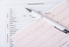 Medical patient registration form with cardiogram and pen Stock Photo