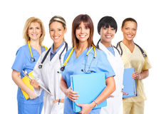 Medical people. Smiling medical people with stethoscopes. Doctors and nurses over white background royalty free stock image