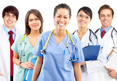 Medical people. Smiling medical people with stethoscopes. Doctors and nurses over white background stock photo
