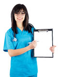 Here Are Some Good News. Medical people: brunette female doctor/nurse in blue coat showing on her chart stock photo