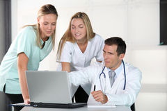 Medical people in front of laptop computer Stock Images