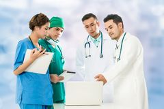 Medical People Meeting with Laptop Computer. Medical People Group Meeting - Surgeon, Nurse And Doctor In Meeting Discuss On Computer For Illness Diagnosis royalty free stock image