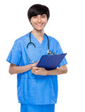 Medical person with clipboard Stock Image