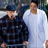 Medical personel helping. An old man Royalty Free Stock Photos