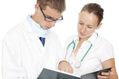 Medical persones. Young medical persons looking in the programing notebook Stock Photos