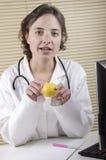 Medical personnel explains the importance a lemon Stock Photo