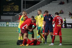 Medical personnel FC Rubin assists injured player Stock Photography